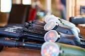 stock photo of paintball  - A shot of some paintball guns in a row with a slight dof effect - JPG