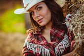 picture of cowgirl  - beautiful cowgirl style closeup model model on farmland - JPG