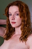 stock photo of implied nudity  - Closeup on the beautiful face of a young redhead - JPG