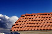 Roof Tiles And Blue Sky In Nice Day