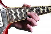 foto of fret  - Hand fretting some notes on a Gibson SG guitar - JPG