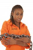 picture of jumpsuits  - A woman in her orange prision jumpsuit wrapped up in a chain - JPG