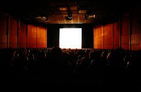 foto of movie theater  - in cinema focus on screen people in hall  - JPG