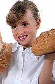 Girl with loaves of bread