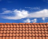 picture of red roof tile  - Roof tiles and sky with clouds at nice sun day - JPG