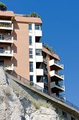 picture of mudslide  - Urban houses on the mountain cliff over sky - JPG