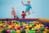 foto of pool ball  - Happy children playing in ball pool at a party - JPG