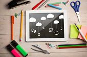 foto of computer-generated  - Composite image of digital tablet on students desk showing cloud computing doodle - JPG
