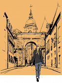 picture of stroll  - Woman strolling in an old city in France  - JPG