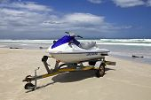 stock photo of jet-ski  - Jet ski, Life Saver - parked at the beach in Cape Town, South Africa