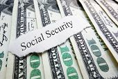 stock photo of social-security  - Social Security newspaper scrap on assorted money - JPG
