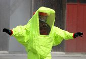 picture of biological hazard  - fearless rescuer with the yellow suit against biological hazard from contamination