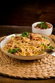 picture of carbonara  - Delicious spaghetti with bacon and egg called alla carbonara on wooden table - JPG