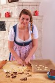 pic of cleavage  - Young Bavarian girl in dirndl with great cleavage and blond braid stands cookies out of a dough - JPG