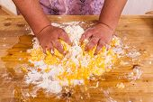 pic of circumcision  - The hands Knead a dough of eggs and flour  - JPG