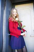 foto of girl next door  - Woman at sunny day next to stain door - JPG