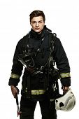 pic of firefighter  - Young firefighter with helmet and axe isolated on white  - JPG