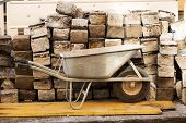 stock photo of wheelbarrow  - wheelbarrow and large stones - JPG