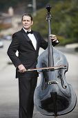 picture of double-bass  - man in tuxedo playing the double bass in the middle of the street - JPG