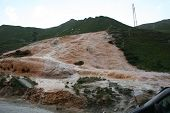 picture of landslide  - Bizarre rock formation exposed by small landslide - JPG
