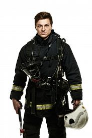 picture of firefighter  - Young firefighter with helmet and axe isolated on white  - JPG