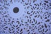 pic of wrought iron  - filigree pattern from white painted wrought iron table - JPG