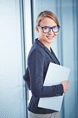 stock photo of secretary  - Pretty young secretary with clipboard looking at camera - JPG