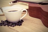 picture of ukulele  - Cup of coffee with ukulele and notebook on wooden table Vintage style - JPG