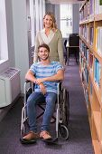 pic of classmates  - Smiling disabled student with classmate in library at the university - JPG