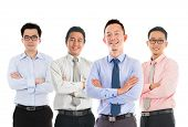 stock photo of southeast asian  - Portrait of group Southeast Asian businessmen standing isolated on white background - JPG