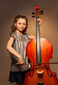 picture of hair bow  - Classy girl with long hair holding the fiddle - JPG