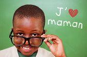 foto of tilt  - Cute pupil tilting glasses against green - JPG