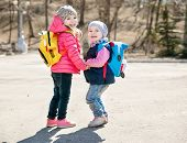 stock photo of little sister  - little sisters in a park in spring - JPG