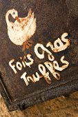 picture of truffle  - Foie gras and truffles on a French restaurant sign