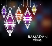stock photo of occasion  - Beautiful Elegant Ramadan Kareem Lantern or Fanous Hanging With Colorful Lights in Night Background for the Holy Month Occasion of fasting - JPG