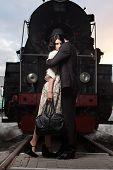 image of locomotive  - parting of lovely couple on railway station at locomotive background - JPG
