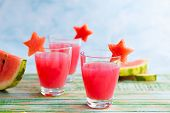 pic of watermelon slices  - Watermelon drink in glasses with slices of watermelon in star shape - JPG