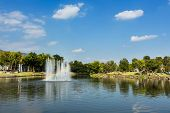 picture of fountain grass  - Fountain with rainbow in the artificial pond - JPG