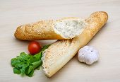 foto of crust  - Fresh crust Baguette with sesame seeds and salad - JPG