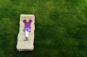 picture of mattress  - beautiful and happy little girl lies on mattress - JPG