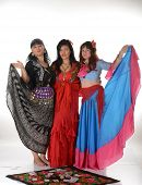 foto of gypsy  - Three gypsy women posing in traditional outfits