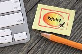 stock photo of reject  - rejected stamp with desk background - JPG