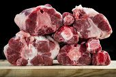 stock photo of cutting board  - Fresh and raw oxtail cut on the cutting board isolated on a black background - JPG