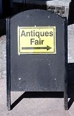 image of bric-a-brac  - Antique sign directing buyers to an outdoor antiques retail fair - JPG