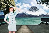 pic of air hostess  - Pretty air hostess looking up against scenic backdrop - JPG