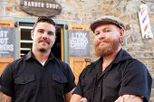 picture of facial piercings  - Portrait Of Two Hipster Barbers Standing Outside Shop - JPG