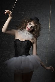 picture of gothic hair  - pretty woman masquerade like bizarre gothic puppet with tutu bowler hat and clown make - JPG