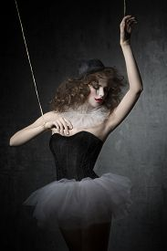 image of gothic girl  - brunette girl posing like marionette dancer with gothic style - JPG