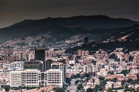 pic of polluted  - Panoramic picture of Bogota city showing a dark sky due smoke and pollution - JPG
