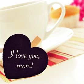 stock photo of i love you mom  - the sentence I love you mom written in a heart - JPG